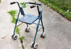 An old antique  wheeled walker used for disabilities. Royalty Free Stock Image