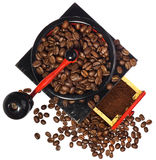 Old antique wooden black and red coffee grinder, coffee beans an Royalty Free Stock Photography
