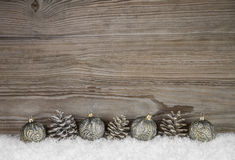 Old antique wooden christmas background with balls and pin corns Royalty Free Stock Image
