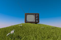 Old antique wooden TV on grassy hill Stock Images