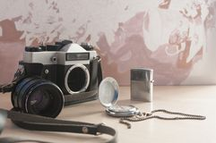 Old antiques 80s. Old antiques of the 80s pocket watch camera lighter made mostly of metal royalty free stock image