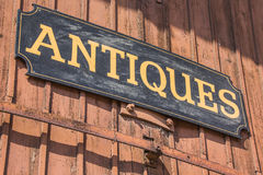 Old antiques sign. Of a shop in Lubeck, Germany Royalty Free Stock Photography