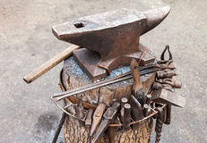 Old anvil with blacksmith tools Stock Photo