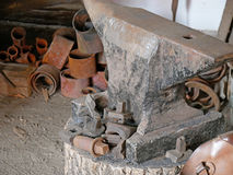 Old anvil in a forge. The blacksmith workshop. Old anvil in a forge Stock Photography