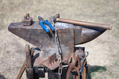 Old anvil with many blacksmith tools Royalty Free Stock Photography