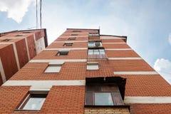 Old apartment block of brick Stock Photos