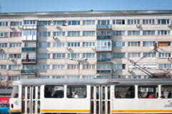 Old apartment block and trams Stock Image