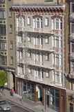 Old Apartment Building. An old downtown apartment building as view from another building across the street stock photo