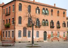 Old apartment building, red, in Murano in the town of Venice Veneto (Italy) Royalty Free Stock Images