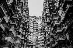 Old apartment buildings in black and white color Stock Photos