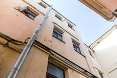 Old apartment buildings on blue sky background Royalty Free Stock Photos