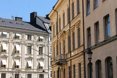 Old apartment buildings in city. Exterior of old high rise apartment buildings in European city Royalty Free Stock Image