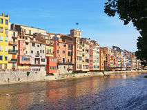 Old Apartment Buildings on Onya River, Girona, Spain. Many colourful traditional apartment buildings alongside the Onya River, Girona Old Town, Spain Royalty Free Stock Image