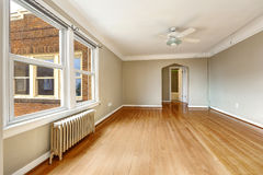 Old apartment interior. Empty living room with radiator Stock Photo