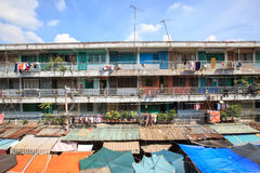The old apartment at Ngo Gia Tu with outdoor market in the morning Royalty Free Stock Image