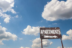 Old Apartment Sign. A old sign advertising an apartment for rent Stock Images