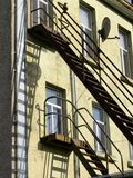 Old Apartments. Rear of view of apartments with fire escape Stock Photography
