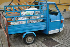Old ape piaggio. Old ape piaggio used to transport garbage in Milan, Italy Royalty Free Stock Photo