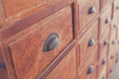 Old apothecary cabinet. Close-up of a very old apothecary cabinet stock image