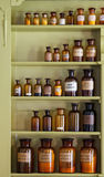 Old apothecary cabinet with storage jars royalty free stock photography