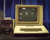 Old Apple II computer system at event exhibition. DALLAS, TX, USA-APR 26, 2019: Apple II computer with foam-molded plastic case. It was the first consumer royalty free stock images