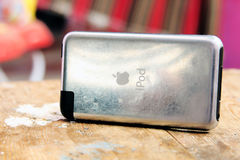 Old apple ipod touch. The first generation of  used apple ipod touch on wooden background Royalty Free Stock Photography