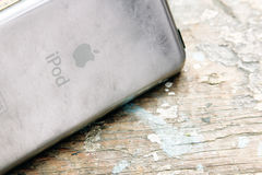 Old apple ipod touch. The first generation of  used apple ipod touch on wooden background Royalty Free Stock Image