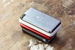 Old apple ipod touch with other mobile phones Royalty Free Stock Photography
