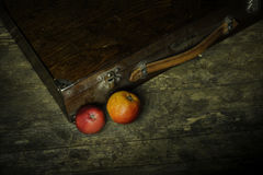 Old apples and vintage case Royalty Free Stock Photo
