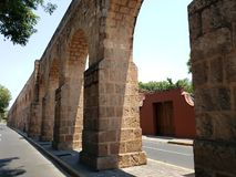 Old aqueduct in the city  of Morelia, Michoacan, travel and tourism in Mexico. Old aqueduct city morelia michoacan travel tourism mexico arch arches stone style royalty free stock image