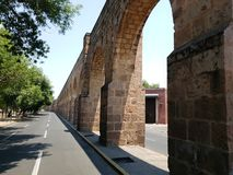 Old aqueduct in the city  of Morelia, Michoacan, travel and tourism in Mexico. Old aqueduct city morelia michoacan travel tourism mexico arch arches stone style stock photos