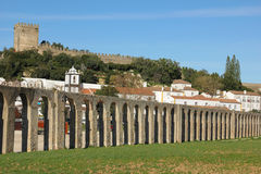 Old aqueduct. Obidos. Portugal. A XVI century aqueduct with the fortified citadel in the background. Obidos. Portugal Stock Image