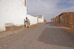Old arab man walking Stock Images