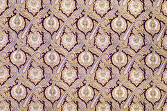 Old arabesque style ornament. Brown background textile with arabesque style ornament Stock Image
