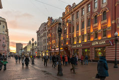 Old Arbat pedestrian street. Moscow, Russia - January 3, 2016: Old Arbat pedestrian street in the winter at sunset Royalty Free Stock Photo