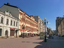 Old Arbat street, Moscow. Old Arbat street exists in Moscow since 16th century. It`s famous among tourists for its street artists and souvenir shops now. It`s a Stock Photos