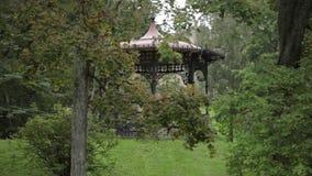 Old arbor in the autumn garden park in Riga city stock footage