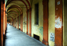 Old arcade street in Bologna. Arched old street orange color in bologna, Italy Royalty Free Stock Images