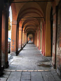 Old arcade street in Bologna. Arched old street orange color in bologna, Italy Stock Photos