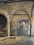 Old arcades in Saluzzo. In the lower old town Stock Photography