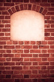 Old arch arc niche with copy space in brick wall background. Old stone arch arc niche with space for text frame in brick wall background Stock Photos