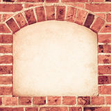 Old arch arc niche with copy space in brick wall background. Old stone arch arc niche with space for text frame in brick wall background Royalty Free Stock Photo