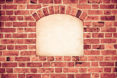 Old arch arc niche with copy space in brick wall background. Old stone arch arc niche with space for text frame in brick wall background Royalty Free Stock Images