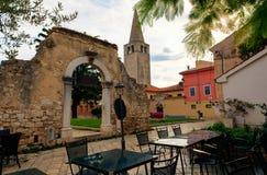 Old Arch in Dobrile Juraj Square. Porec, Istria. Coatia stock photos