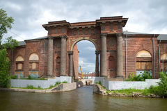 The old arch New Holland. View from the embankment of Moika river, Saint Petersburg Stock Photography