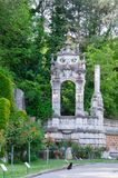 Old arch in the park. Massandra, Crimea - May 28: Old arch in the park of the Massandra palace on May 28, 2016 in Massandra, Crimea Royalty Free Stock Photos