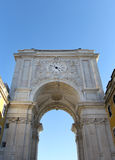 Old arch with watch in the center of Lisbon Stock Photos
