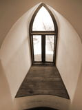 Old Arch Window. Old window in a tower isolated in sepia Royalty Free Stock Photography
