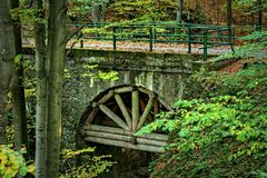 An old arched bridge, reinforced trunks Stock Photo