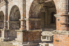 Old arched colonnade of red brick. Royalty Free Stock Image